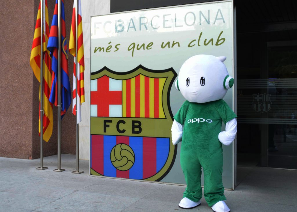 Ollie, the mascot of OPPO, stands alongside the FC Barcelona club